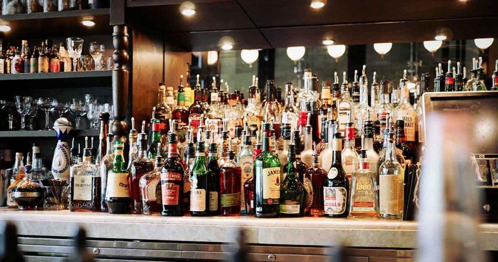 A fully loaded bar of liquor bottles.